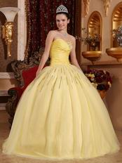 Light Yellow Sweetheart Crystals Decorate Quinceanera Dress